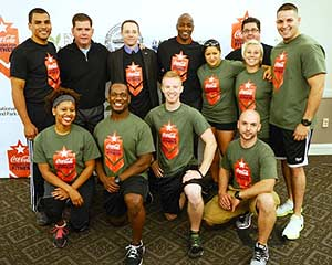 "The first class of ""Troops for Fitness"" instructors are welcomed by (back row, left to right) Veteran's Services Commissioner Francisco Urena, Mayor Martin J. Walsh, Jimmy O'Conner of the National Recreation and Park Association, Dana M. Johnson of The Coca-Cola Company, and Parks Commissioner Chris Cook for the launch of a new free citywide program offering workshops and classes instructed by military veterans at Boston parks and community centers.  (Photo by Jeremiah Robinson)"