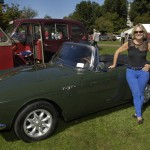 WGBH's Emily Rooney with her late father Andy Rooney's 1966 Sunbeam Tiger than she learned to drive in.