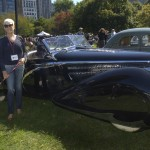 Carol Sawyer poses with the classic French 1948 Delahaye 135M