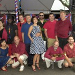 World Music/CRASHarts, Inc.'s Maure Aronson and French Cultural Center's Catheline van den Branden, pose with musicians performing for the Bastille Day party