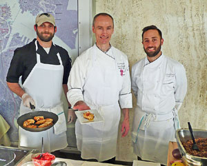 Top of the Hub's Aleksandr Pilyavskiy; Executive Chef, Stefan Jarausch; and Sous Chef, Jason Walker, left to right, welcome guests to the Taste of the Back Bay. (Photo: R. J. Donovan)