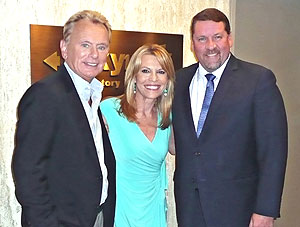 "Pat Sajak and Vanna White, hosts of ""Wheel of Fortune,"" America's most watched game show, were greeted by General Manager Peter Papagelis (left to right), when they recently stopped by the Top of the Hub restaurant to enjoy dinner and tape show segments that will air later this season. (Photo by R.J. Donovan)"
