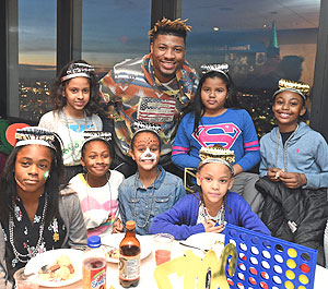Boston Celtics player Marcus Smart, center, is pictured with some of the children from the Boston Centers for Youth and Families. (Photo courtesy of Brian Babineau)